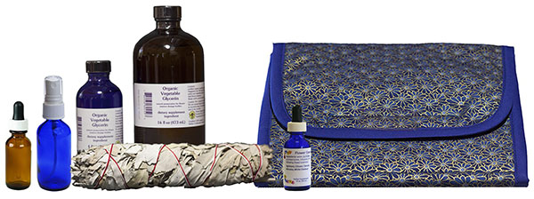 bottle of glycerin, empty bottles, travel bag, dosage bottle, sage smudge stick