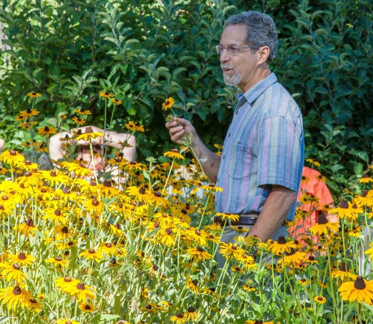 Richard teaching about the Black-Eyed Susan flower in the Terra Flora Gardens